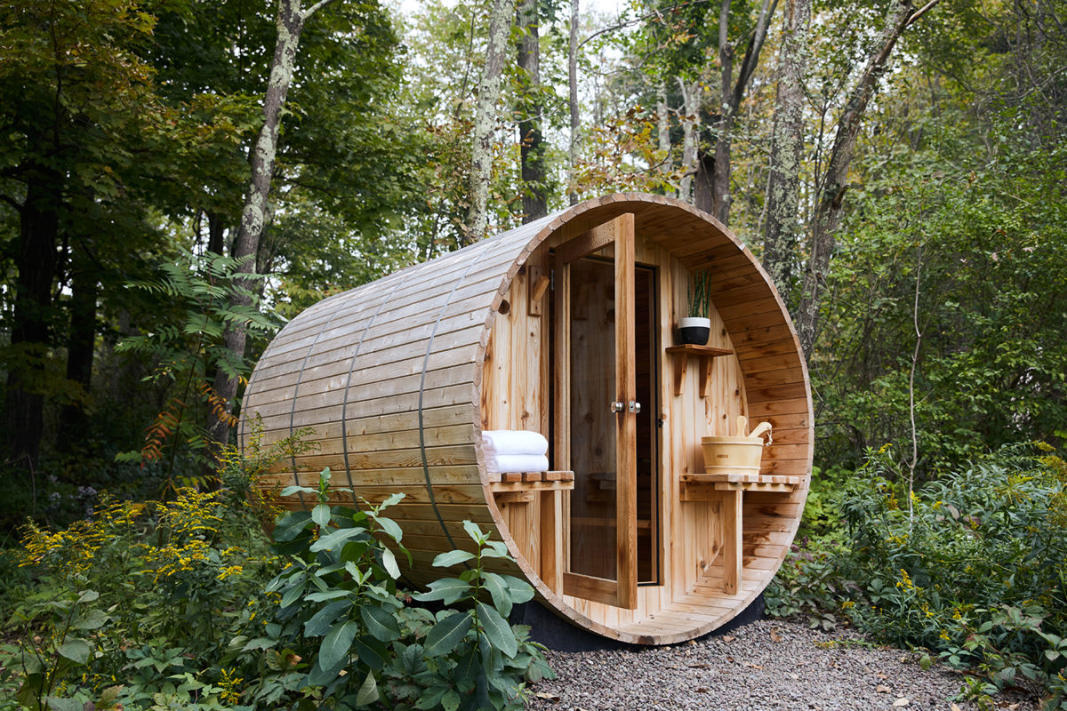a barrel-shaped sauna in the woods