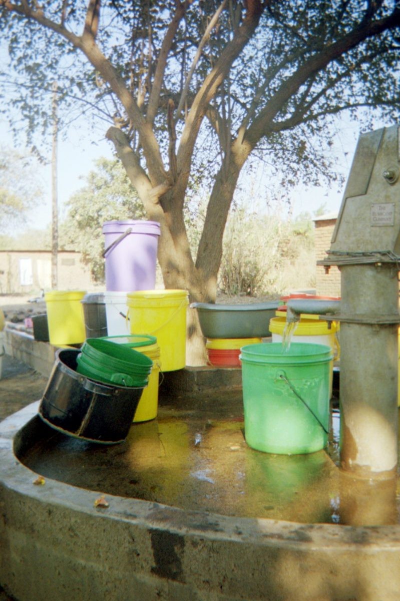 colorful water buckets near the bushcamp company's clean water project wells