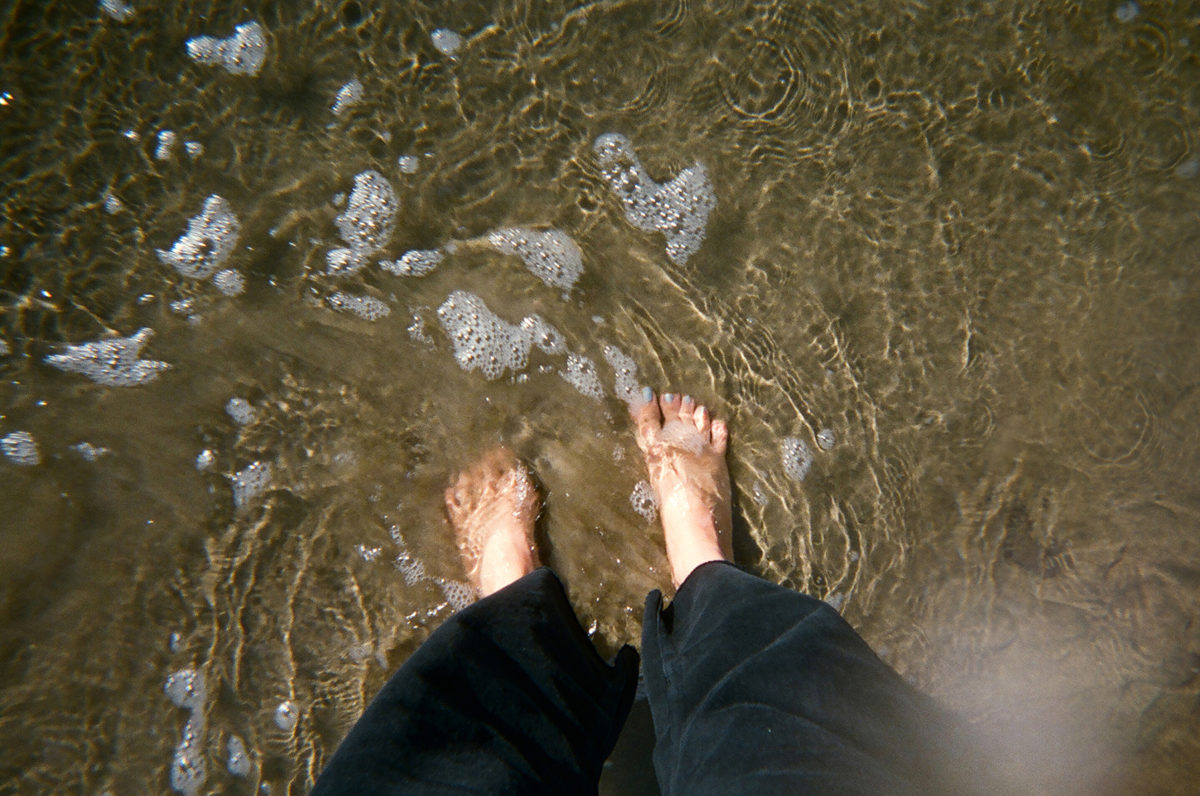 feet at the shore