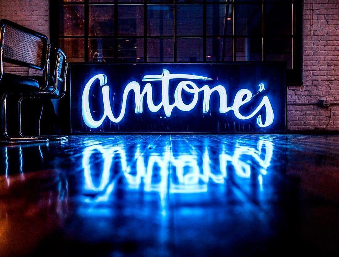 "A blue neon sign reading ""Antone's"""