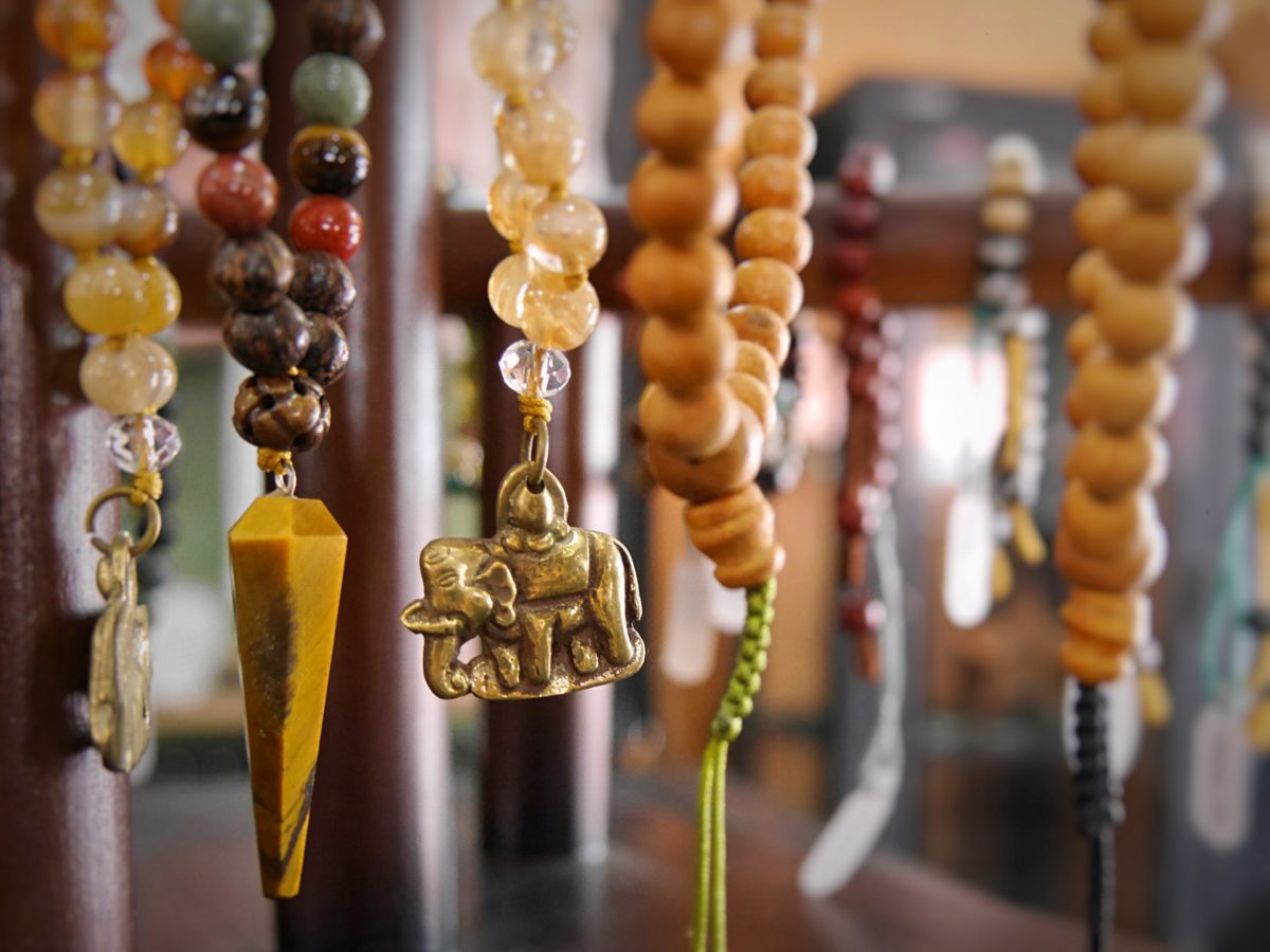 mala necklaces hanging from a stand at Timo Conceptstore in Kathmandu, Nepal