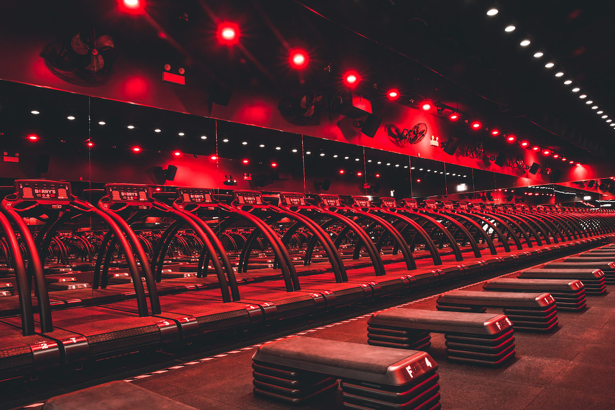 a series of treadmills in a red-lit room