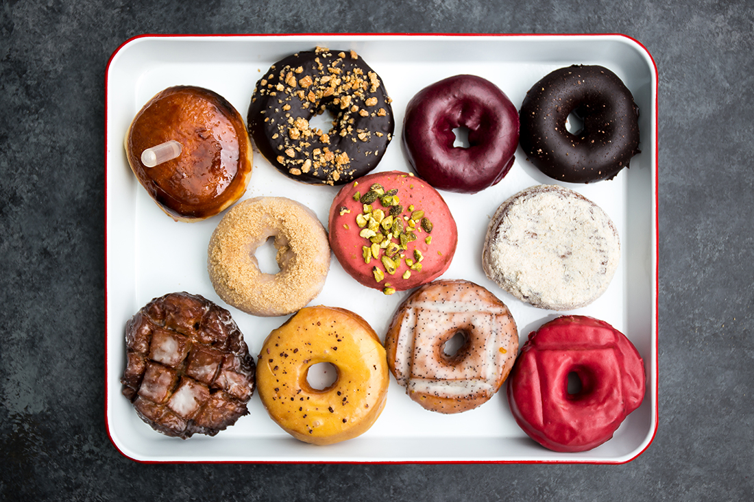 a plate of colorful donuts