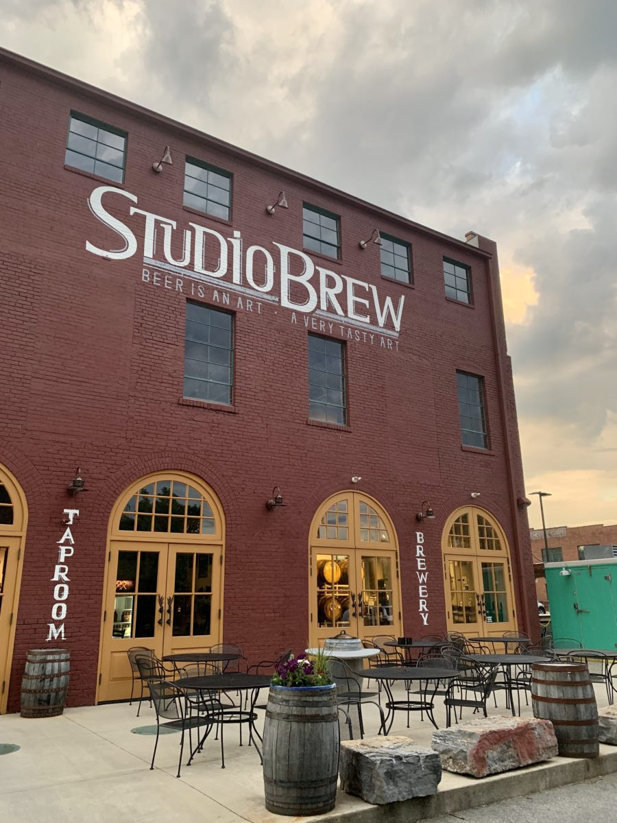 "old building with ""Studio Brew"" written in large white letters."