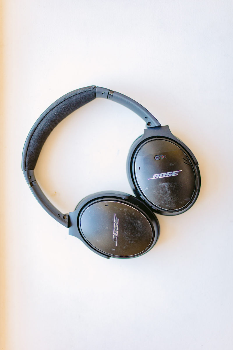 black Bose noise-canceling headphones on white background