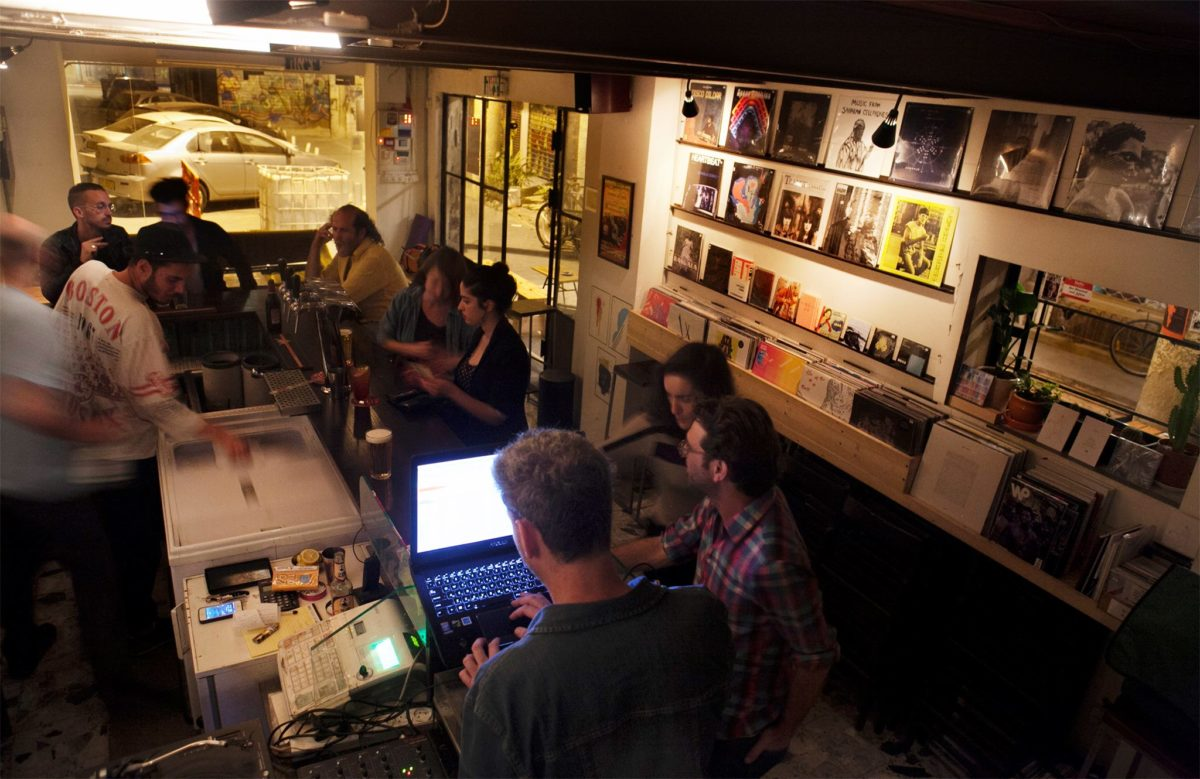 people inside a record shop at night