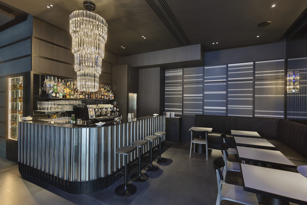 silver and pewter bar with chandelier