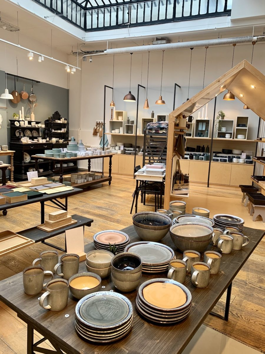 table of plates and bowls in a ceramics shop
