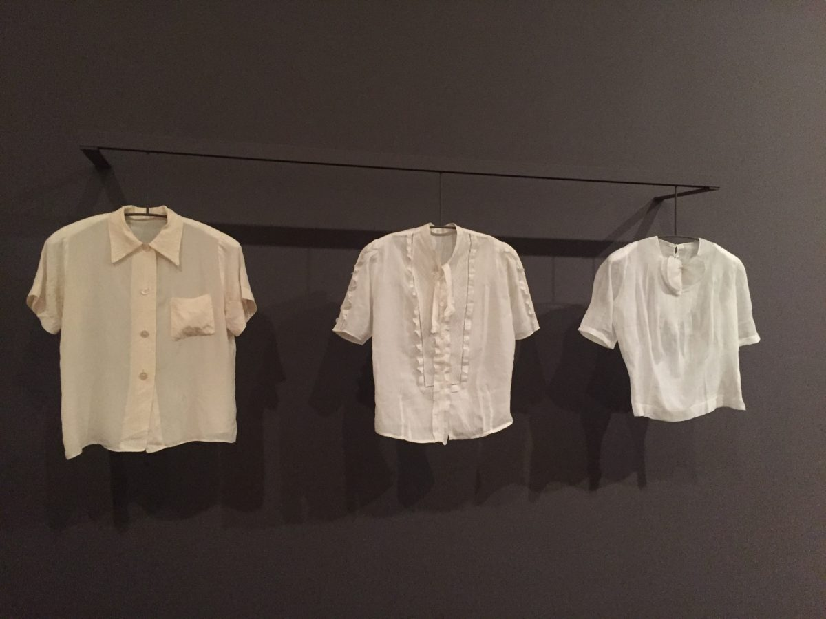 row of shirts in a museum exhibit
