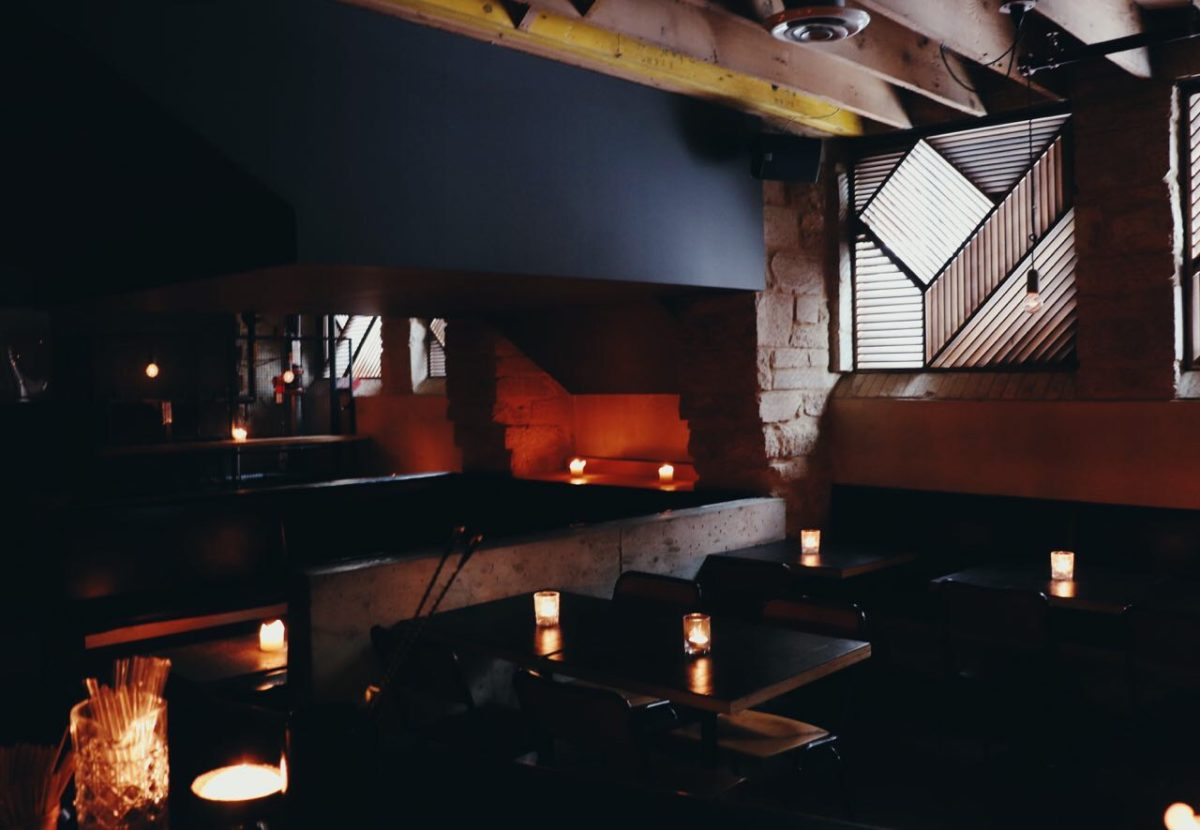 candle lit tables in a dark room
