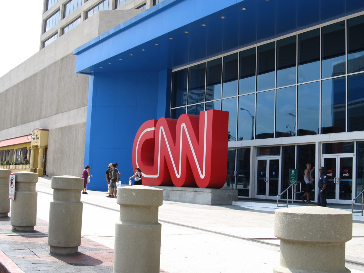 a building with large windows and a CNN sign