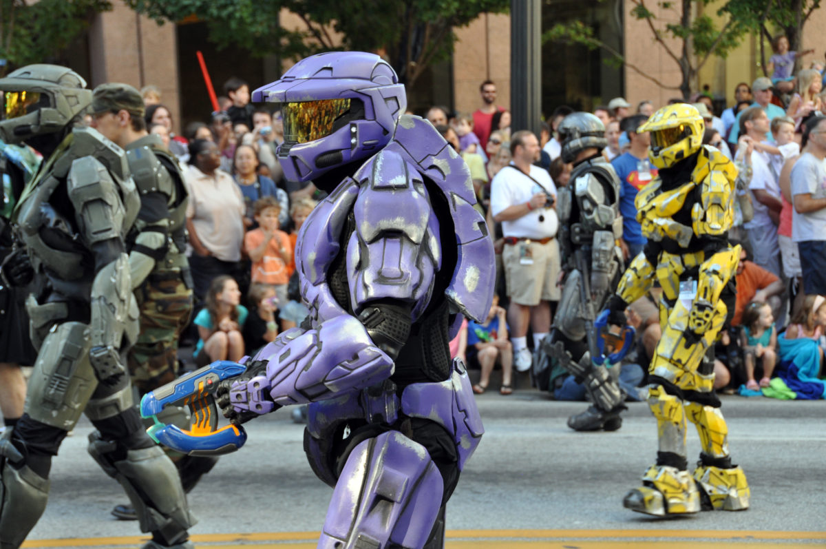 several people in robot costumes at a parade