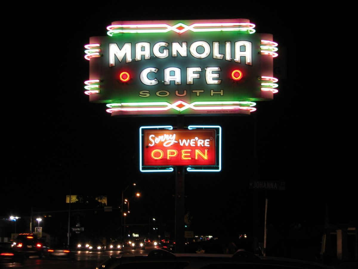 "neon sign at night that reads ""magnolia cafe"""