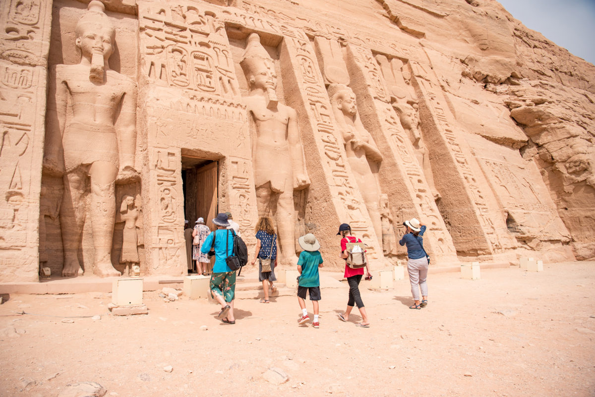 group of parents and kids entering an Egyptian temple
