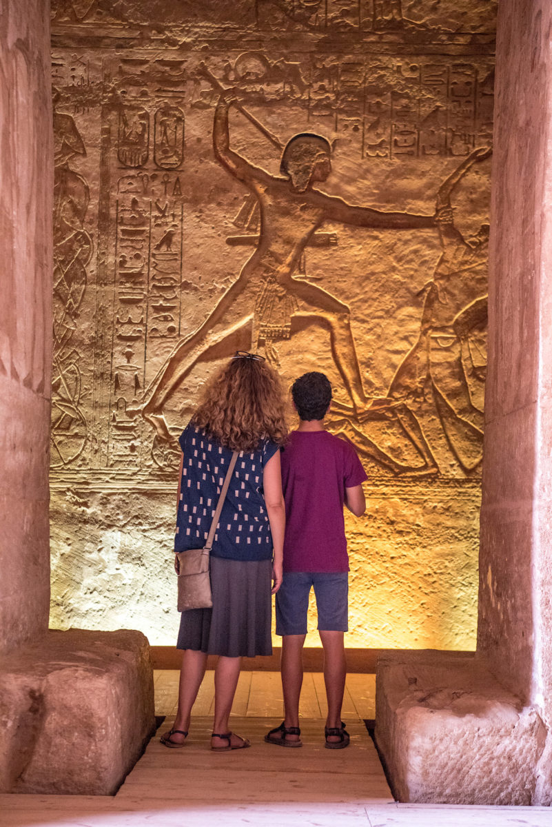 mother and son look at Egyptian hieroglyphs