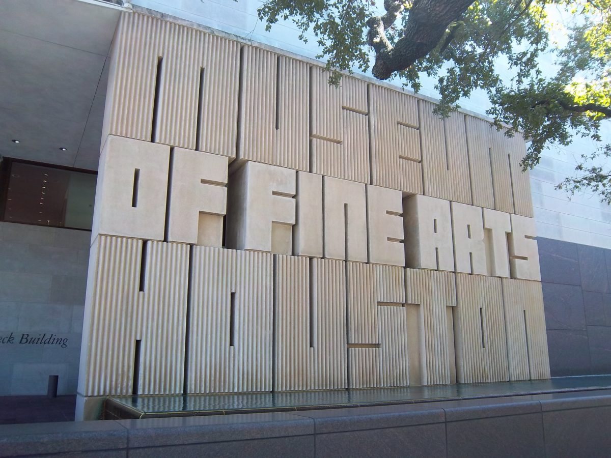 "exterior wooden sign that reads ""museum of fine arts houston"""