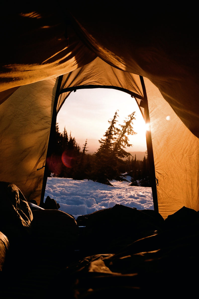 sunrise on a winter day seen from inside a tent