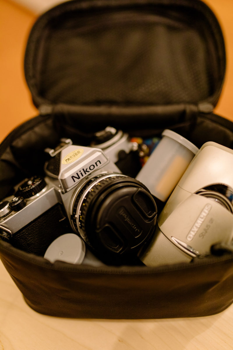 a camera and rolls of film in a bag