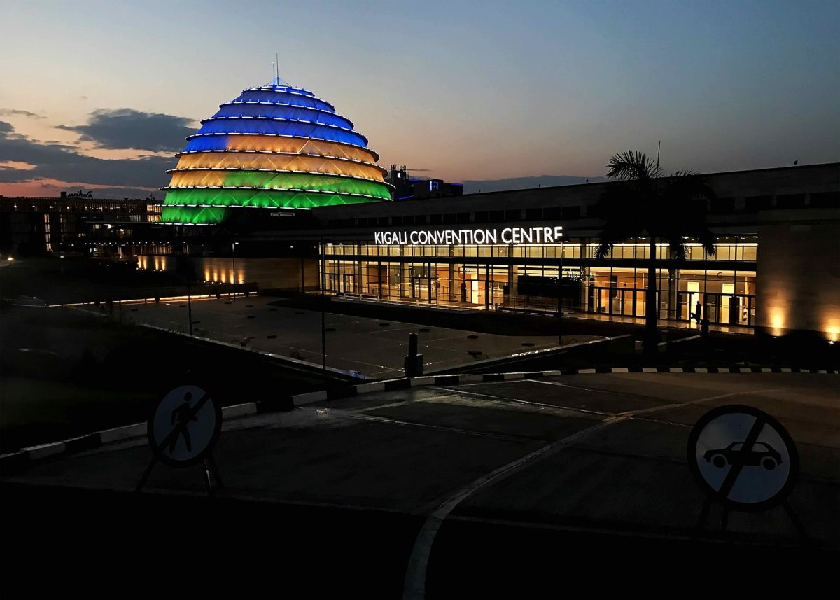 the outside of a building with a neon lit dome at dusk