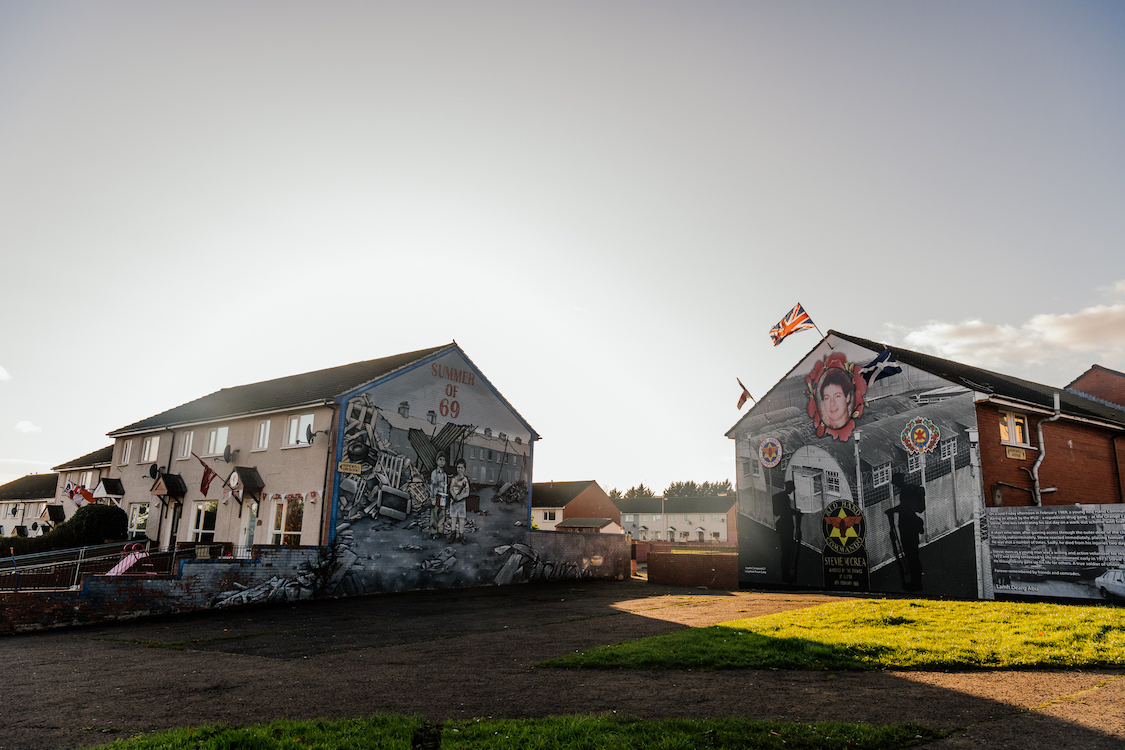 two houses decorated by graffiti at sunrise