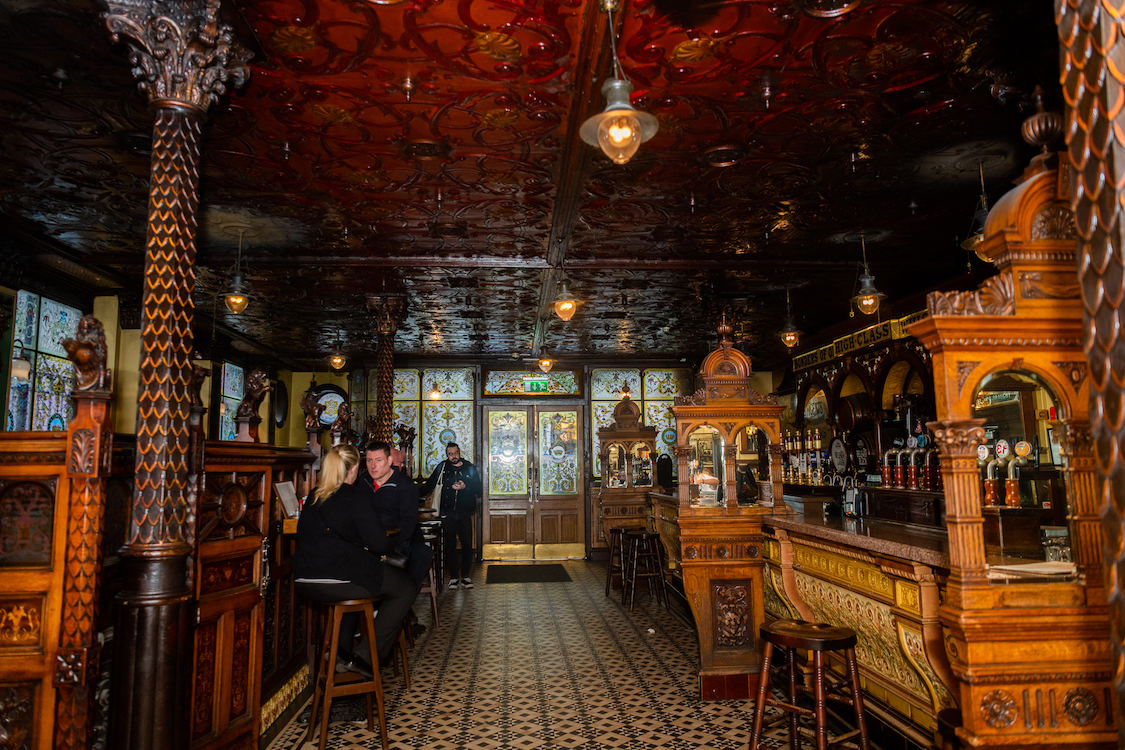 a large antique bar room populated by a few patrons