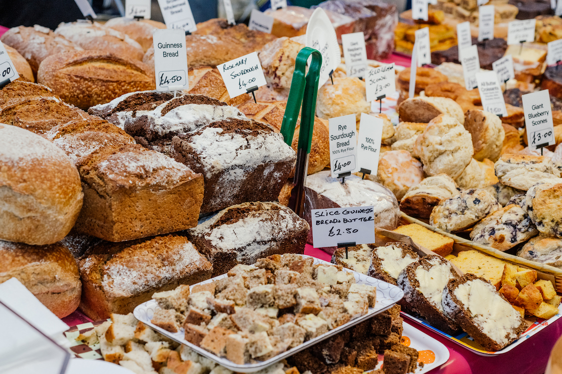 a market display of a variety of breads and pastries