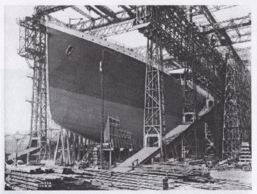 an old photograph of the hull of a ship in a factory
