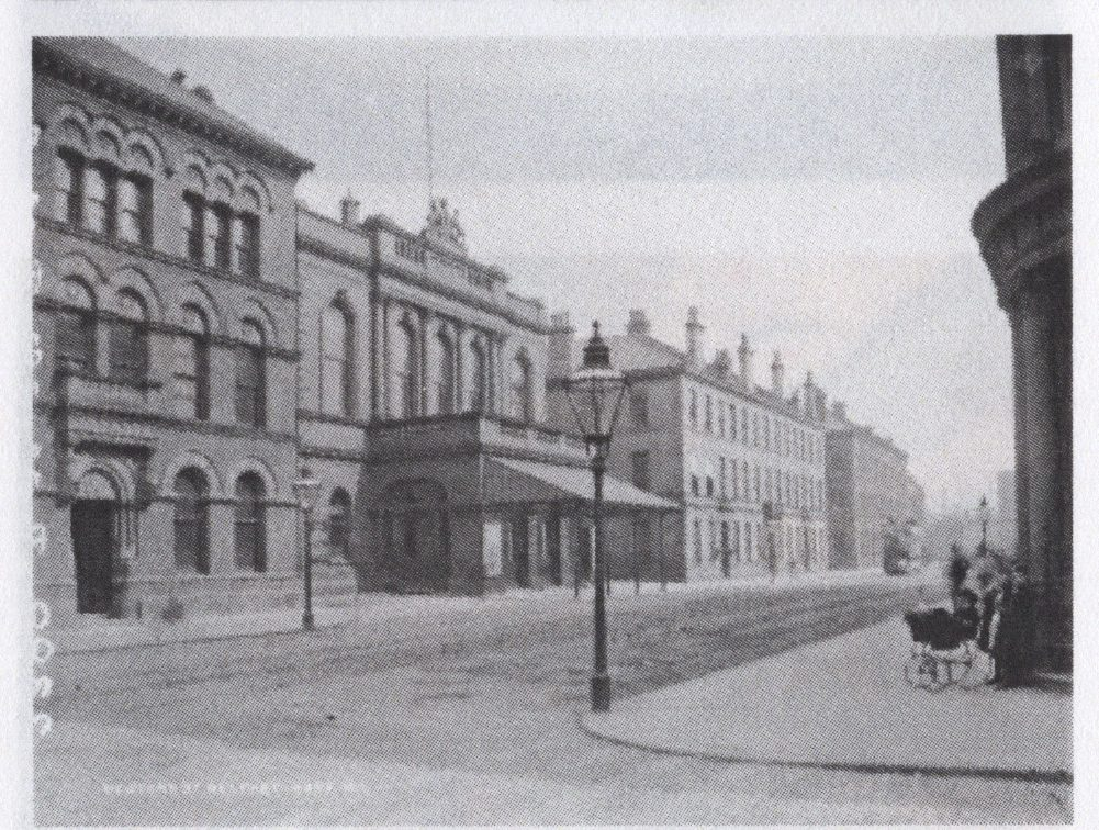 an old photograph looking down a street in the 1900s
