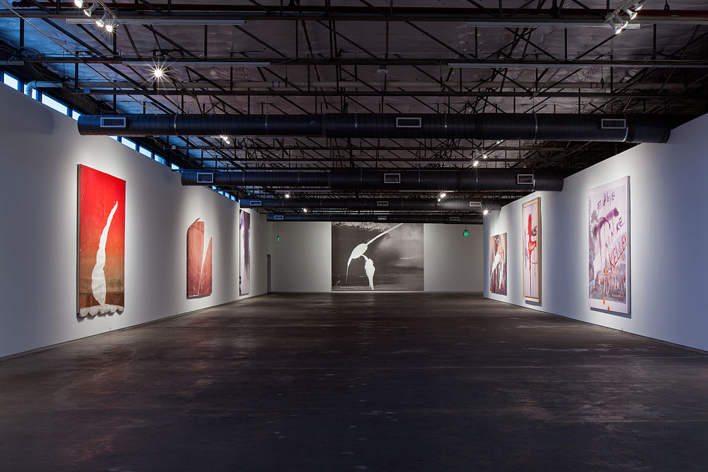 large gallery space with Julian Schnabel paintings on display