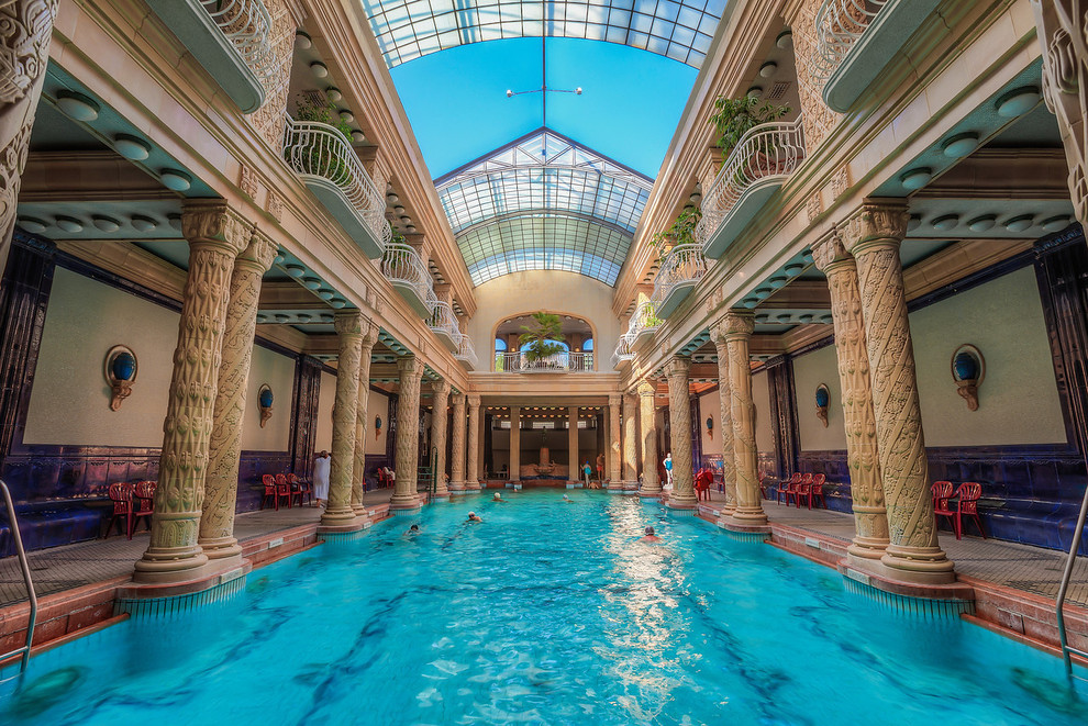 a large indoor public bath with columns and a sunroof