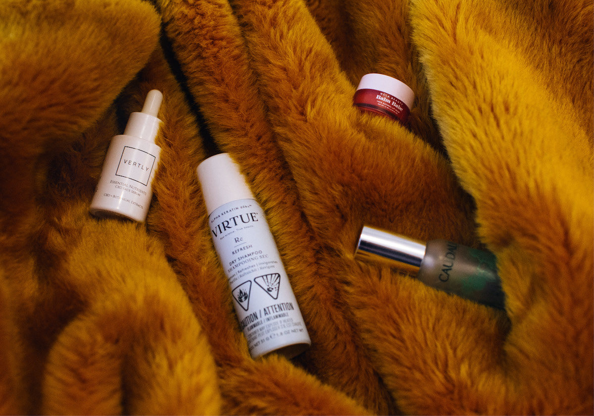 bottles of beauty essentials on a fur textured background
