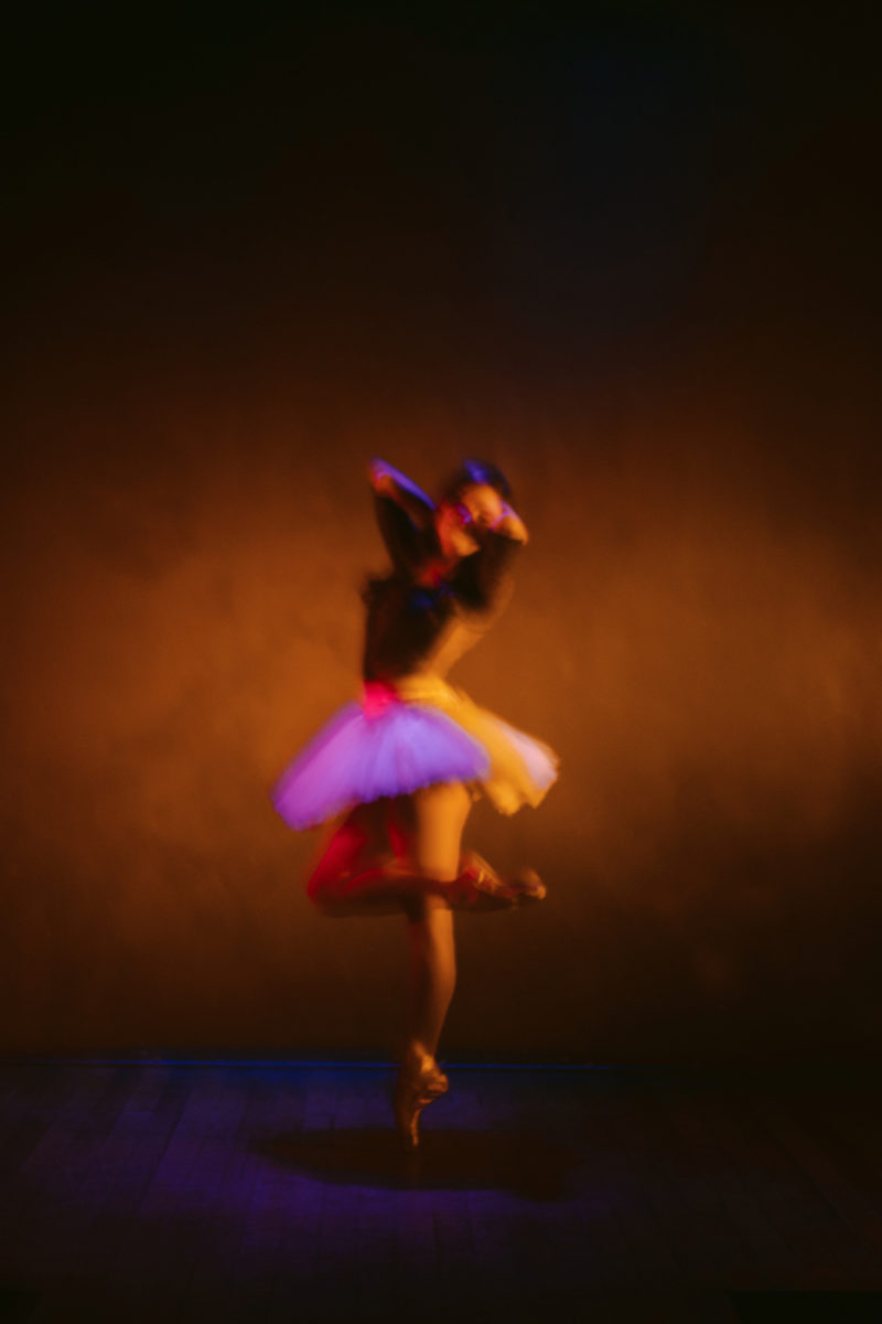 a ballerina posing on stage