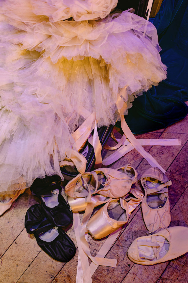 used ballet slippers and a tutu