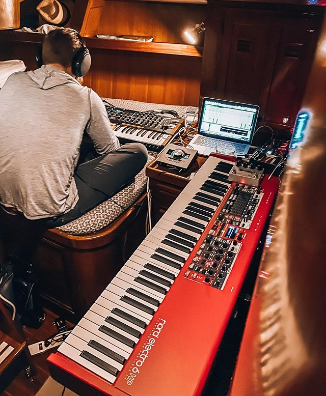 man working in music studio fit inside a sailboat