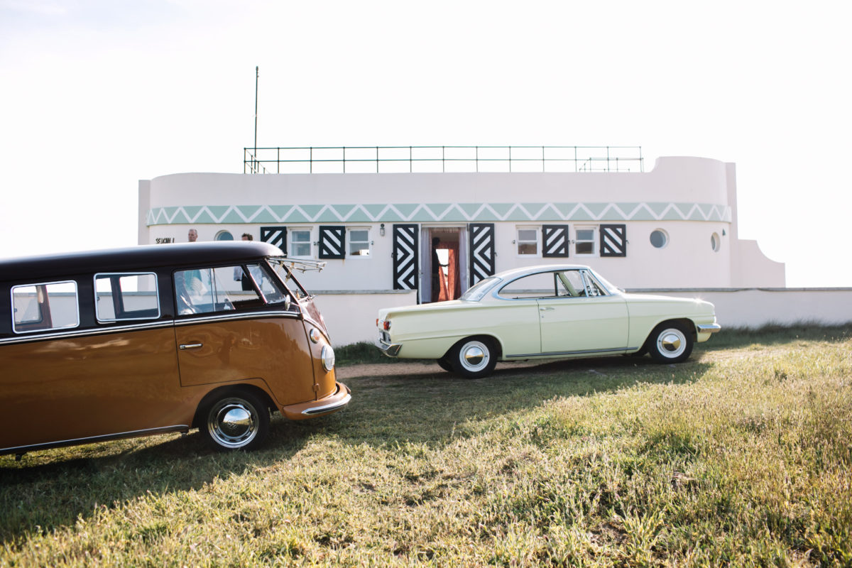 vintage cars parked outside of a stylish trailer