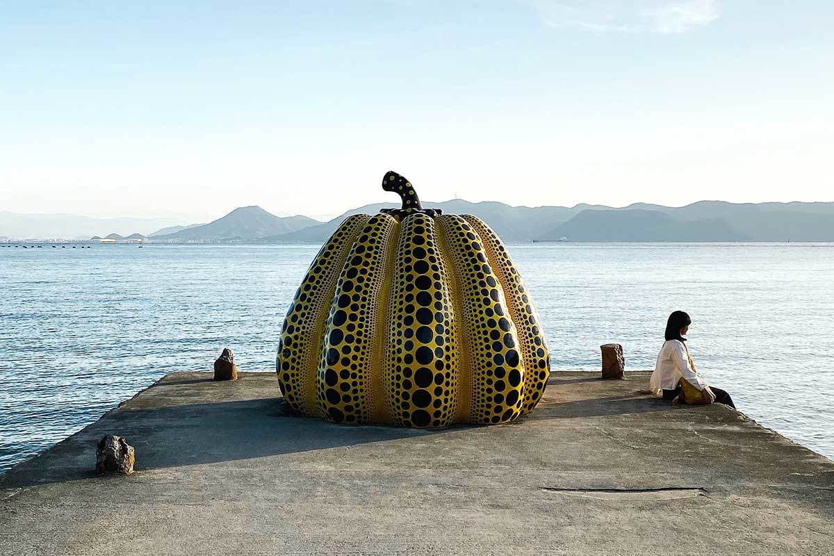 an enormous pumpkin on the edge of a dock