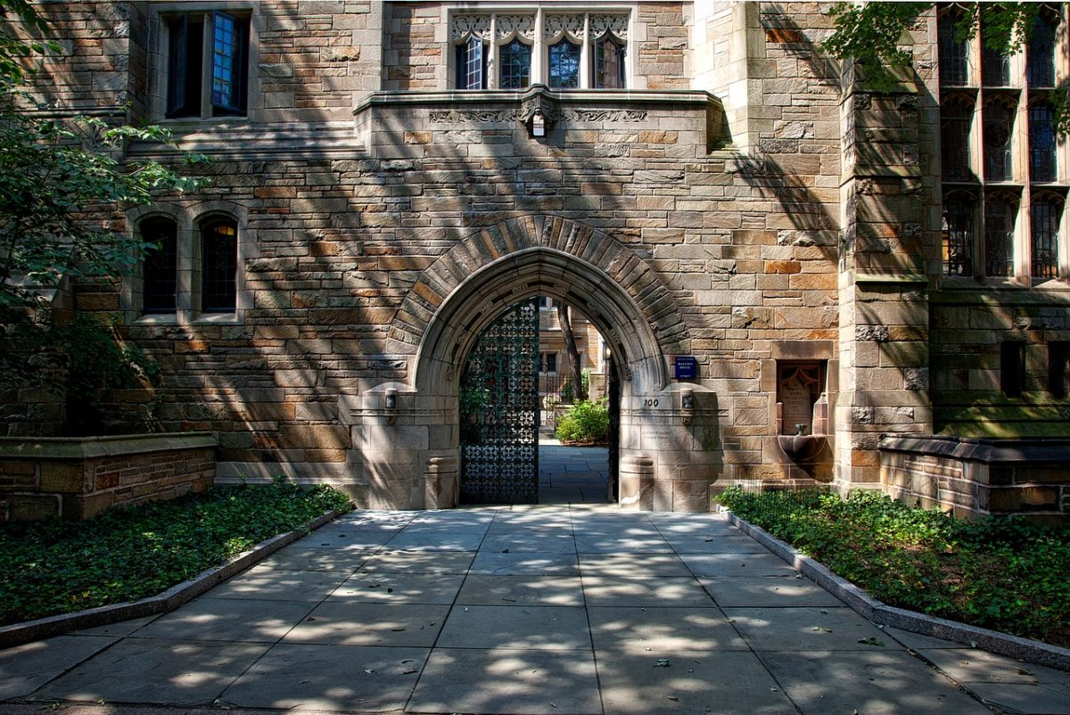 a shaded archway on a university campus