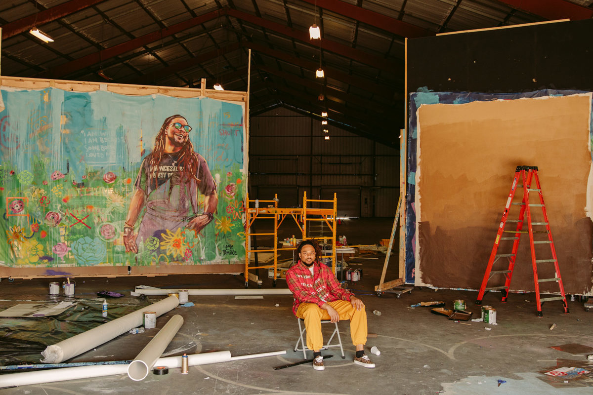 a man sitting in a large art studio