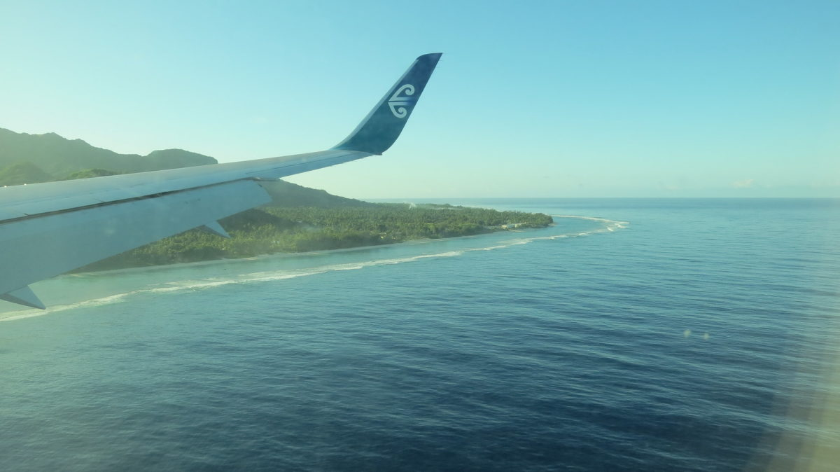 Wing of an Air Rarotonga plane flying into Rarotonga Island