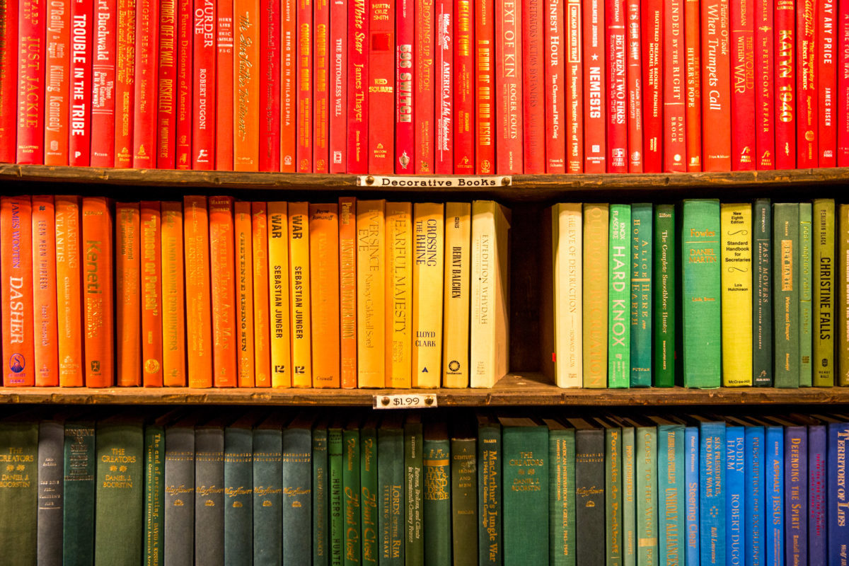 rainbow color coordinated book shelf