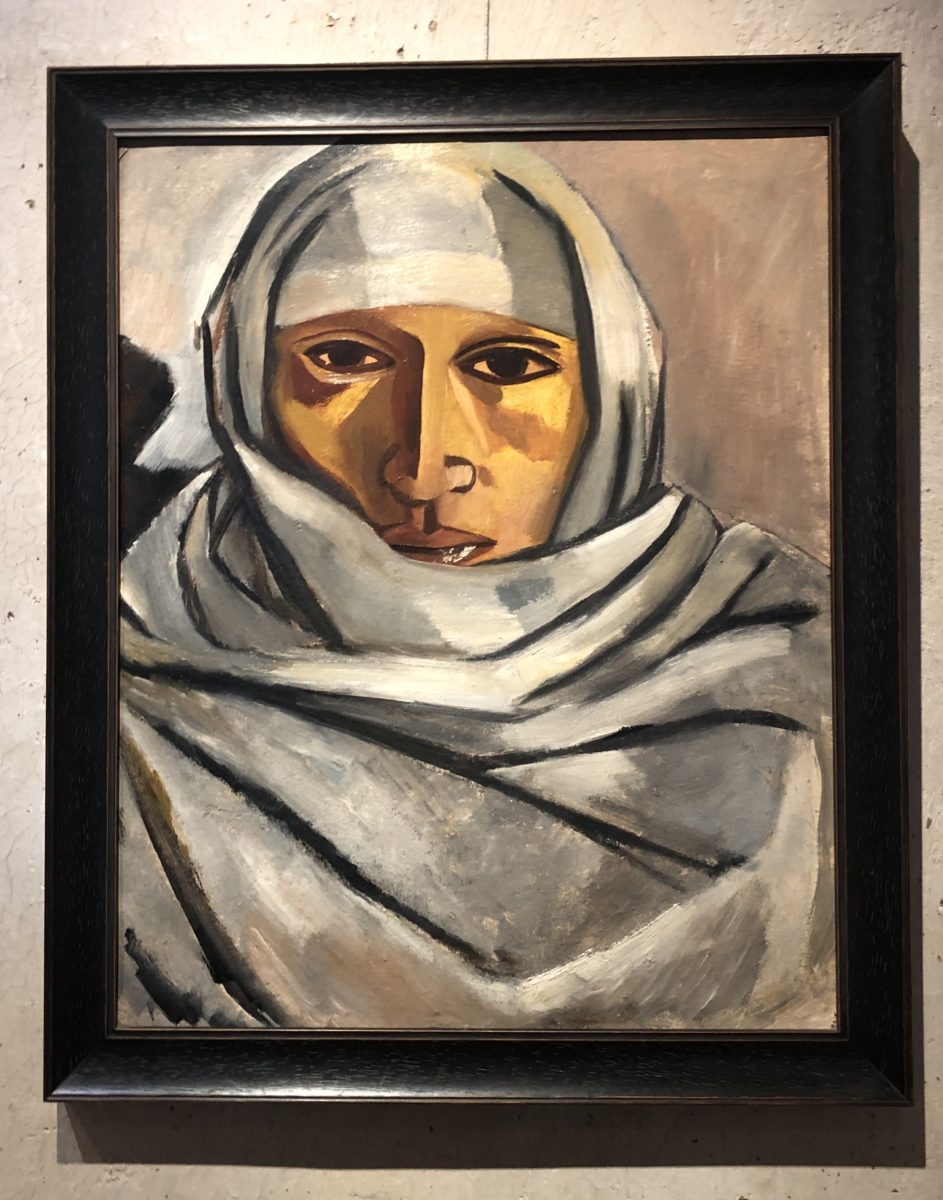 painted portrait of a woman in white headscarf