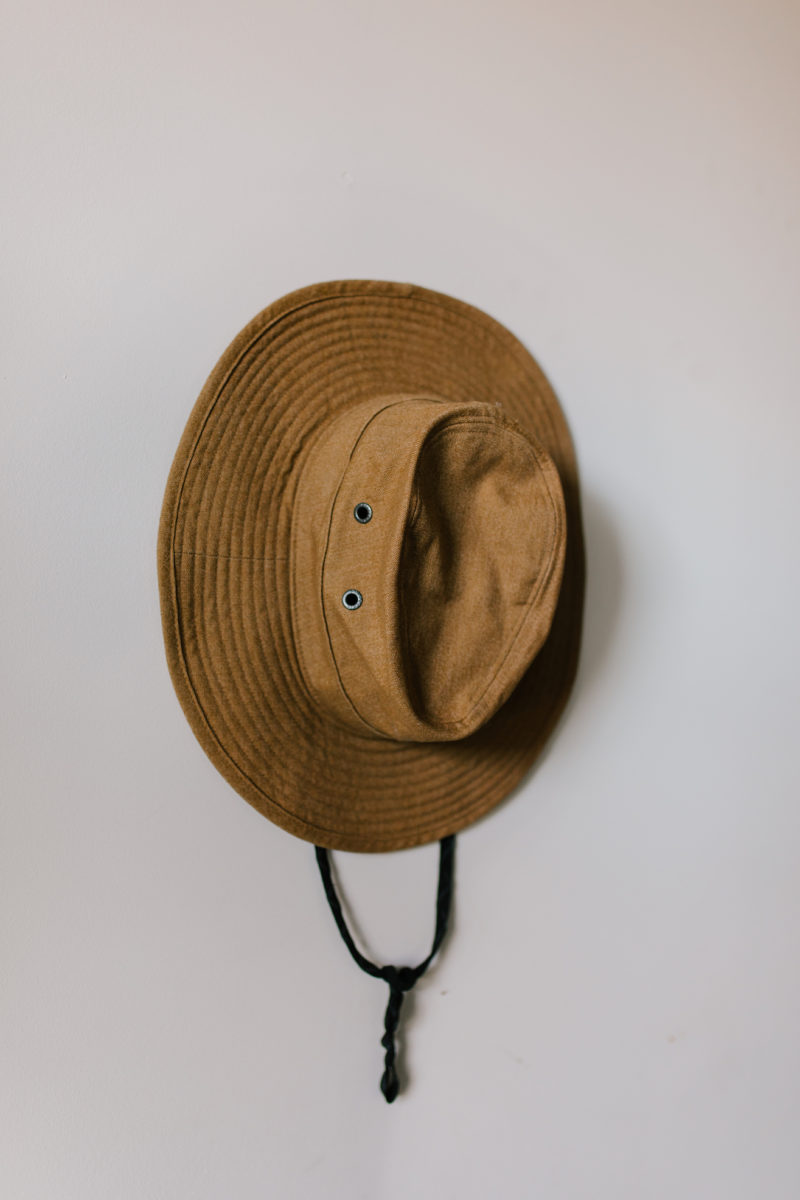 a hat hanging on a wall