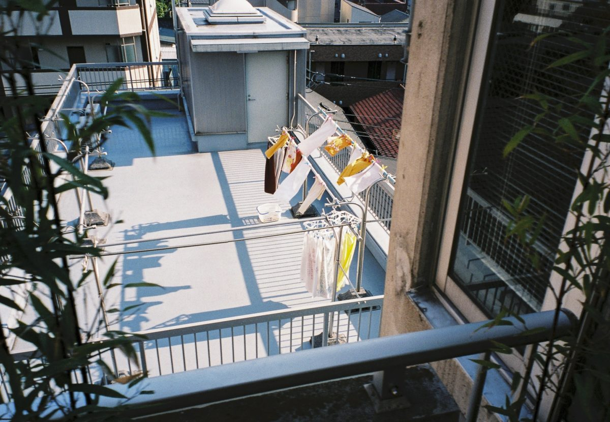clothes on a hanger on an apartment balcony