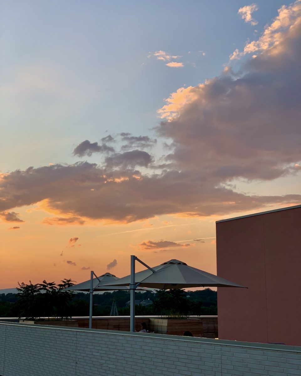 sunset on a rooftop bar with cabana umbrellas