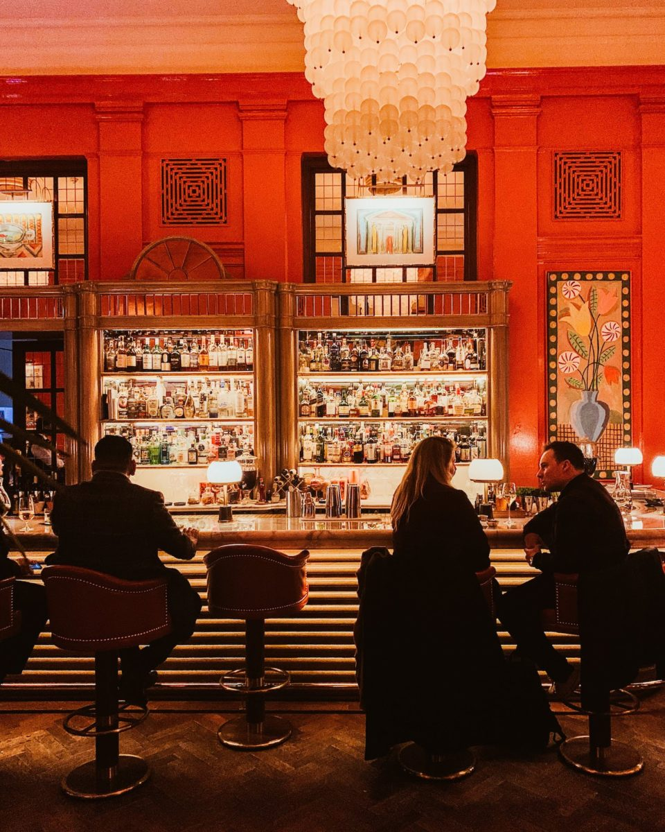 people sitting at an art deco style bar