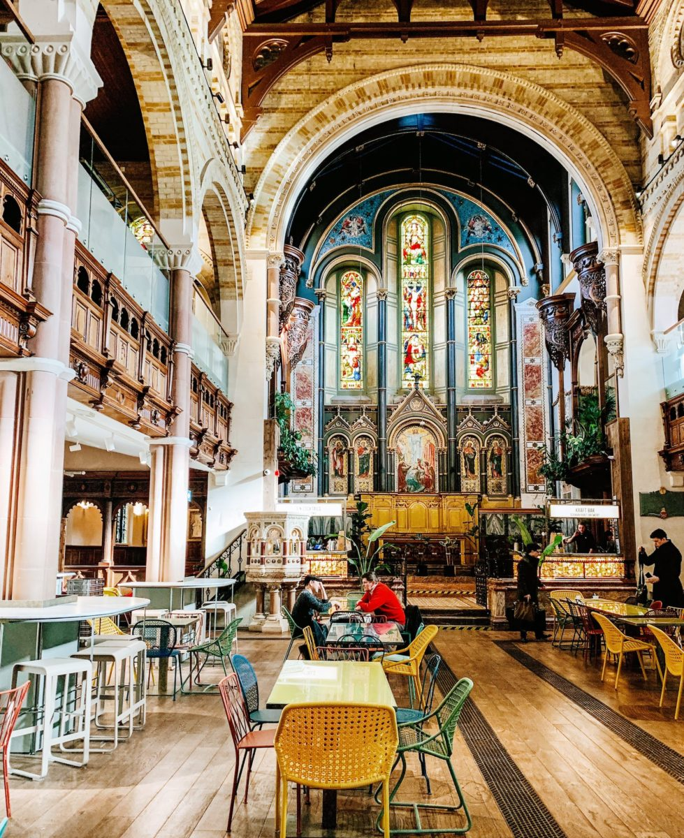a dining hall inside a refurbished church