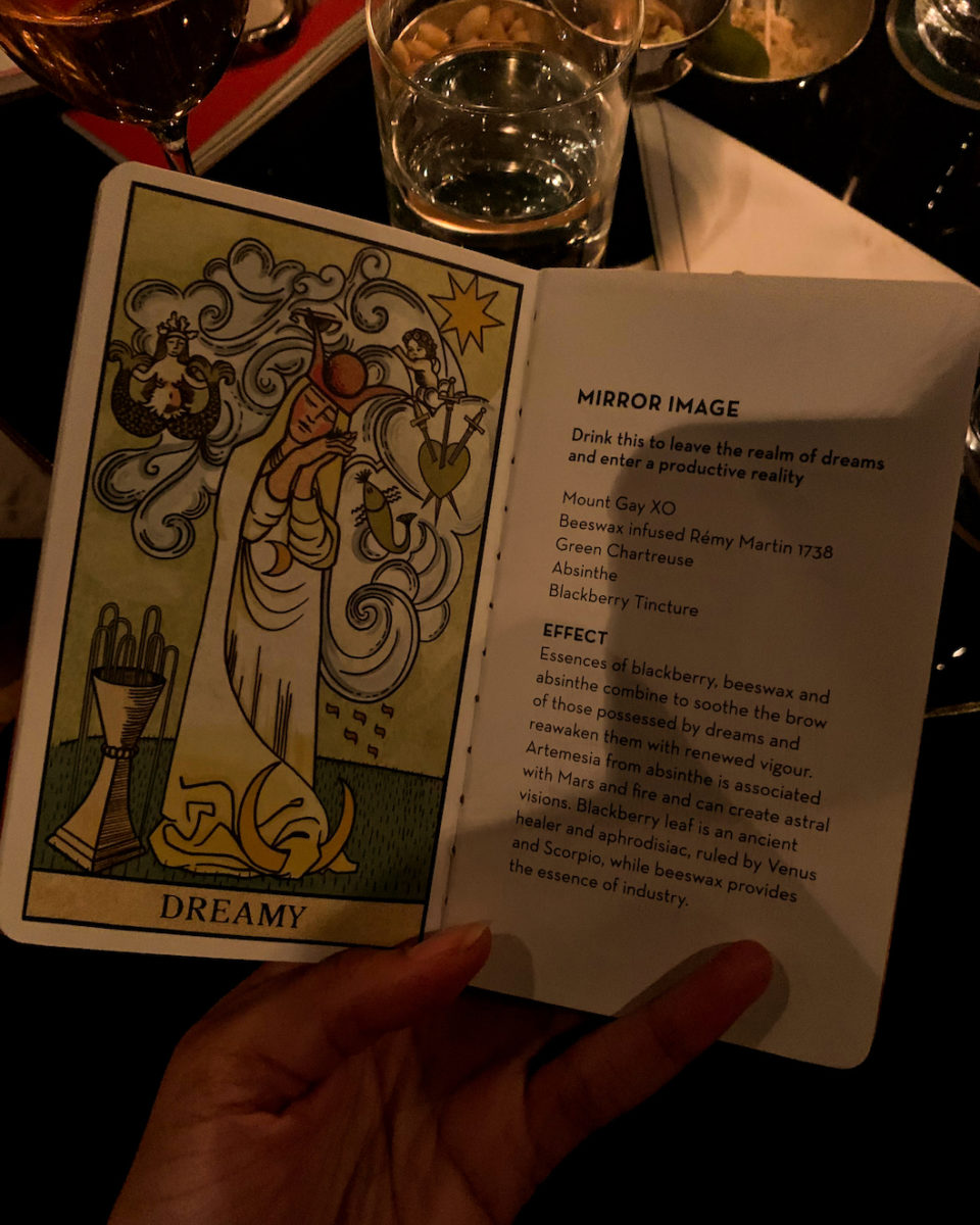 a drink menu resembling a tarot card
