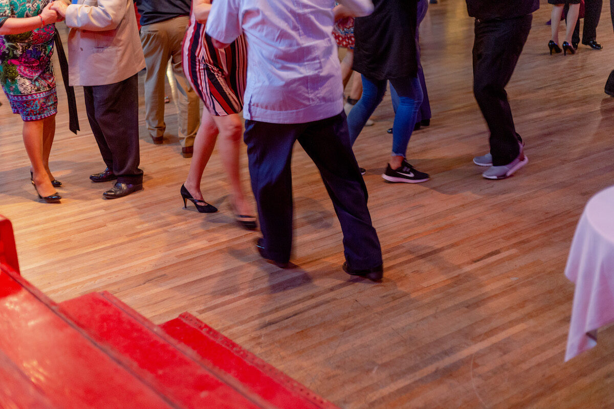 floor shot of people cumbia dancing