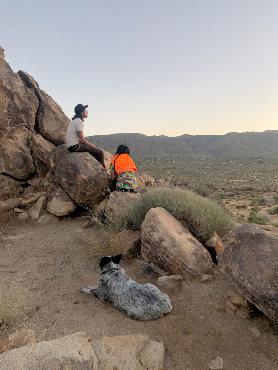 friends climbing desert rocks