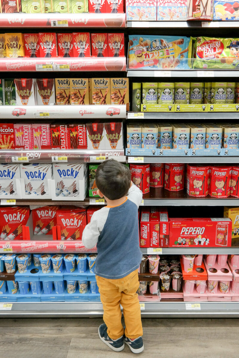 a child in a snack aisle